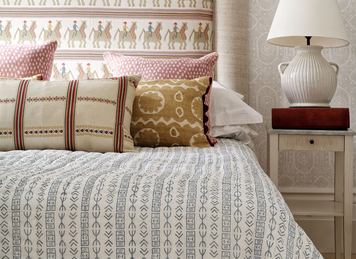 Wicklewood quilt and cushions covering beautifully-laid, king-size bed