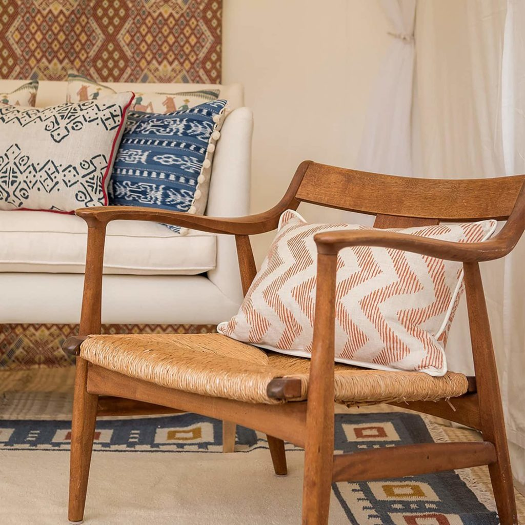 Wicklewood cushions laid on sofa and chair.