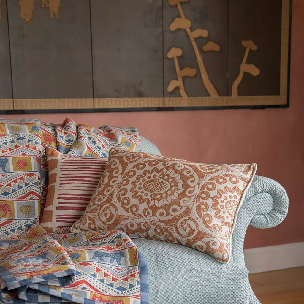 Wicklewood cushions and quilt on sofa in living room.
