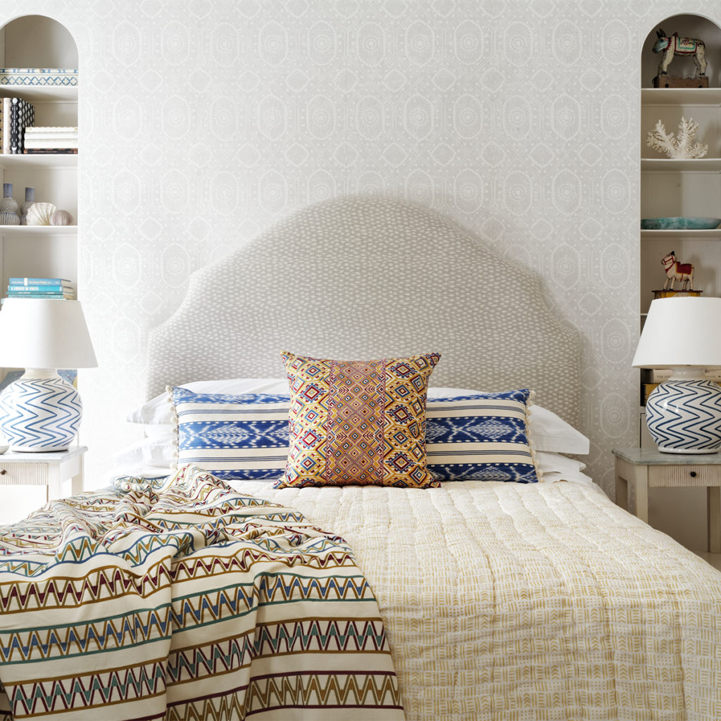 Wicklewood cushions and throw on bed in bedroom